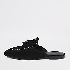 Black tassel studded backless loafers