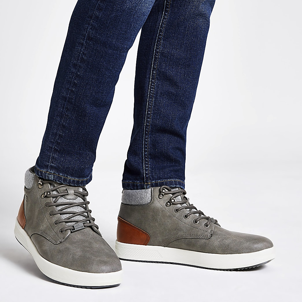 Grey faux leather mid top trainers