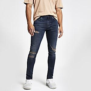 Dark blue distressed Sid skinny jeans