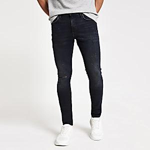 "Schwarz-blaue Superskinny-Jeans ""Danny"" mit Kunstrissen"