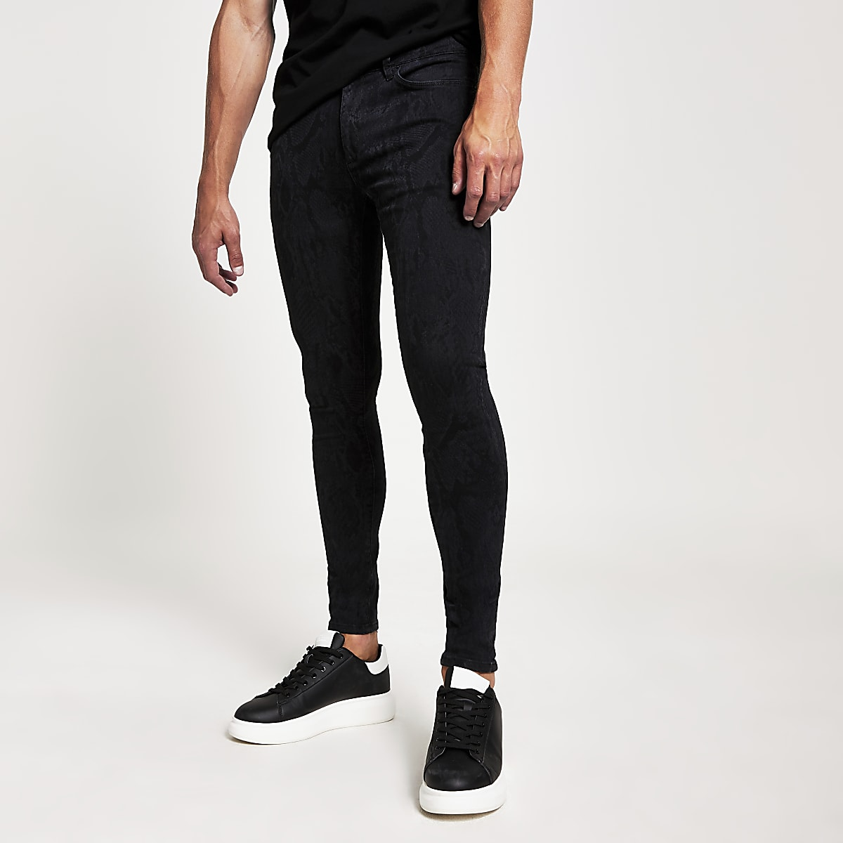 Black snake print spray on Ollie skinny jeans