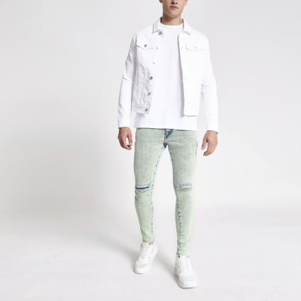 Light blue Ollie spray on ripped jeans