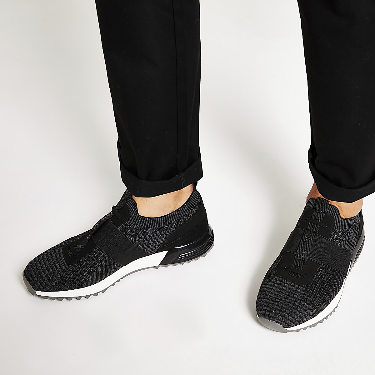 Black textured knit runner trainers
