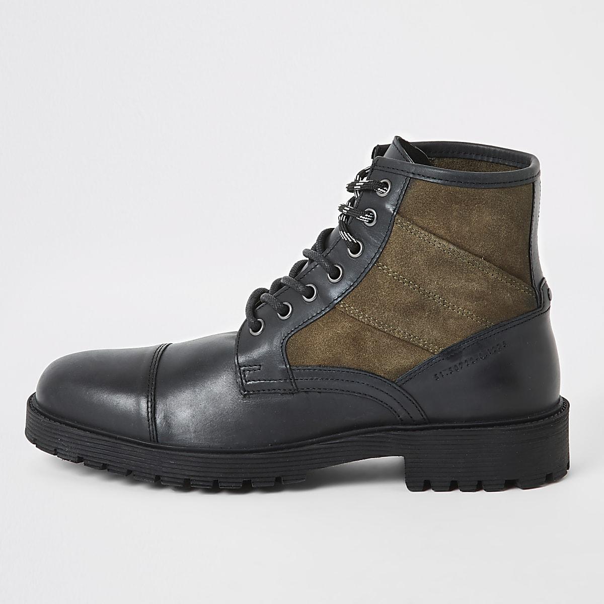 Bottes de randonnée lacées en cuir noir contrasté