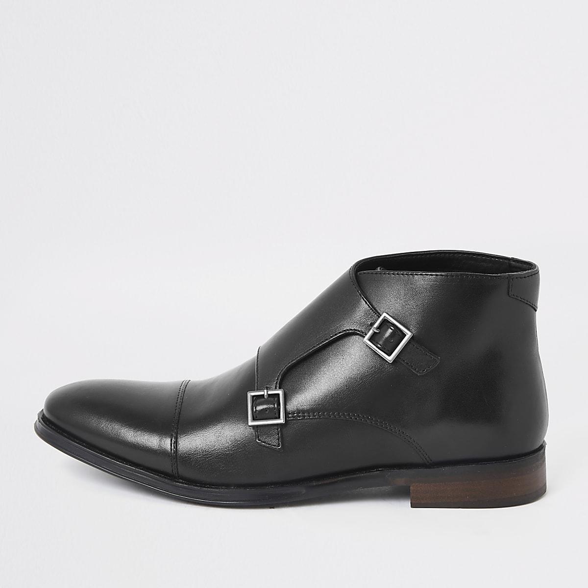 Zwarte leren laarzen met dubbele gesp