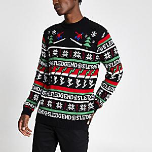 Zwarte gebreide kerstpullover met 'Sledgend'-tekst