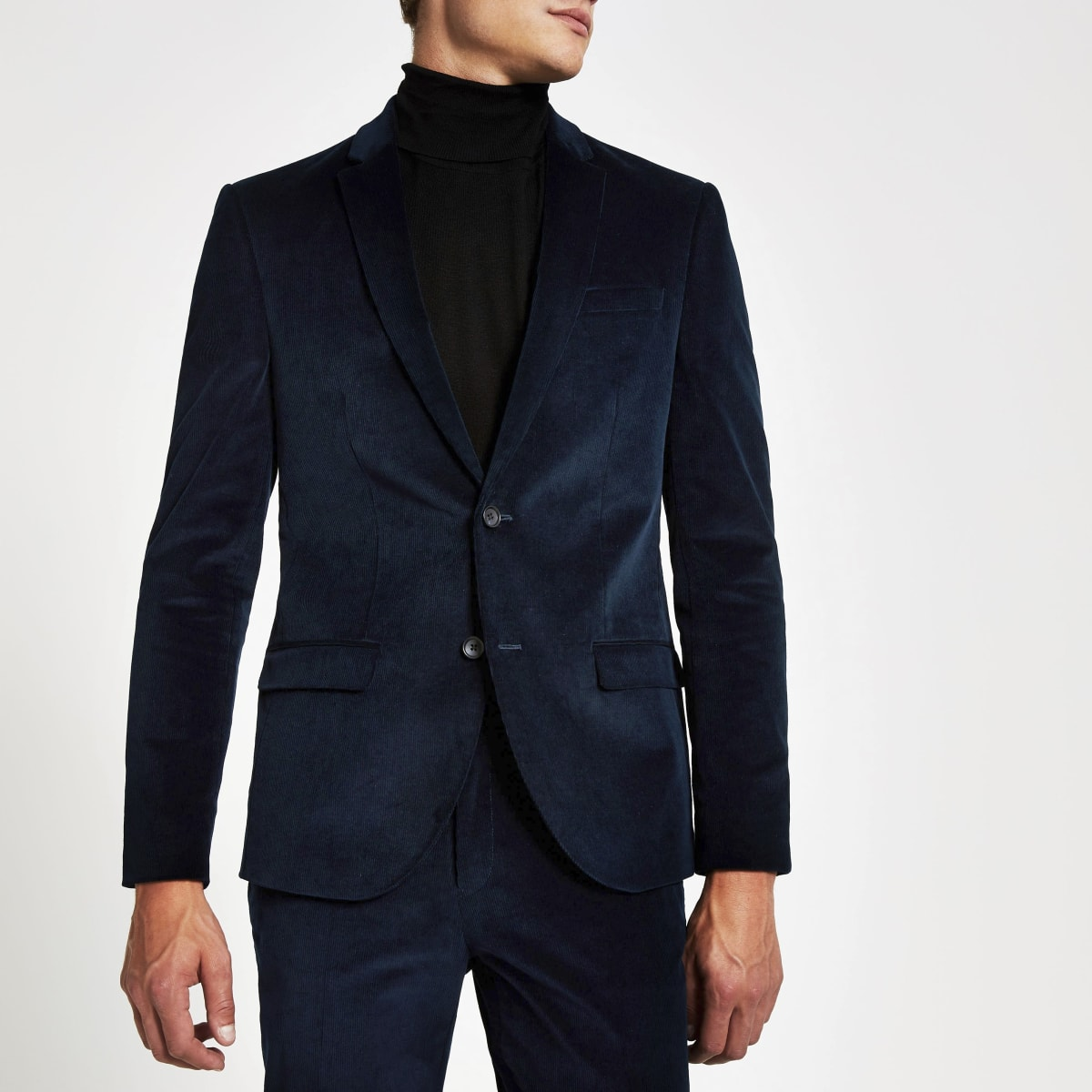 Costume bleu en velours coupe skinny.
