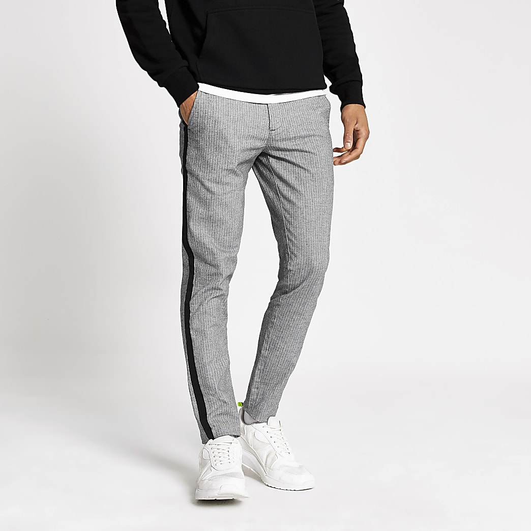 Pantalon skinny grisà rayures etbandes sur les côtés