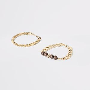 Set van 2 goudkleurige kettingarmbanden met doodshoofd