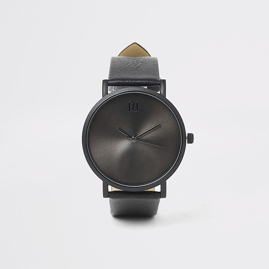 Zwart horloge met ronde wijzerplaat