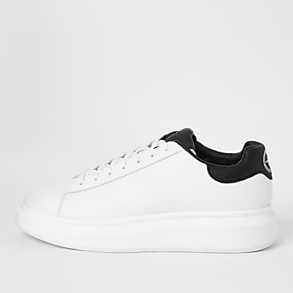 White wedge lace-up trainers
