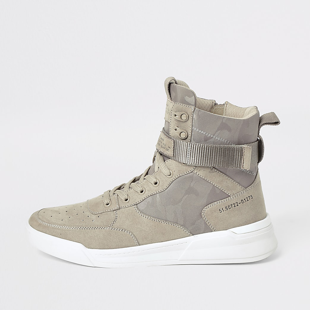 Kiezelkleurige hoge sneakers met sleehak