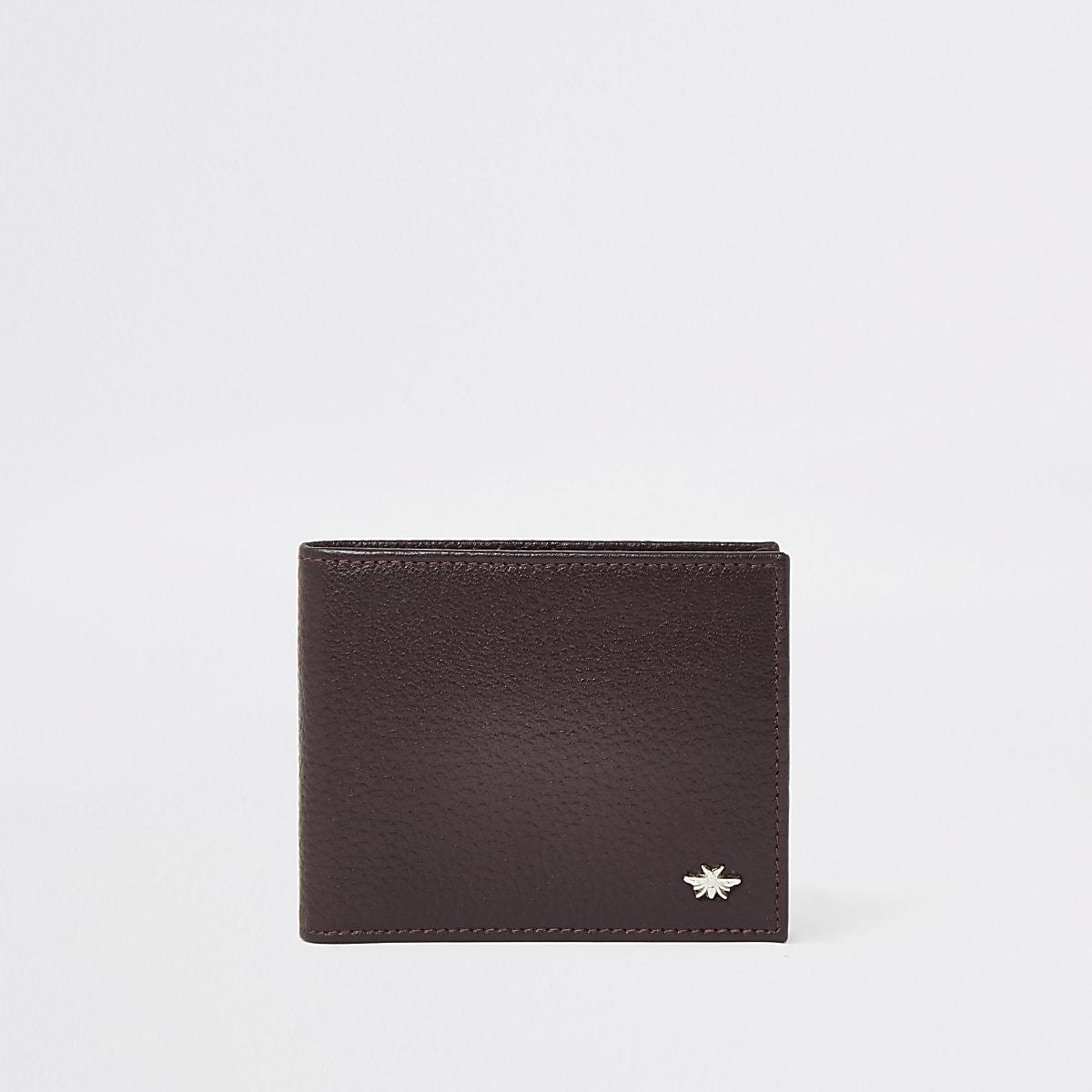 Portefeuille en cuir rouge texturé motif guêpe