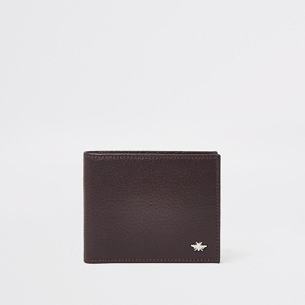Rode leren portemonnee met wesp en textuur