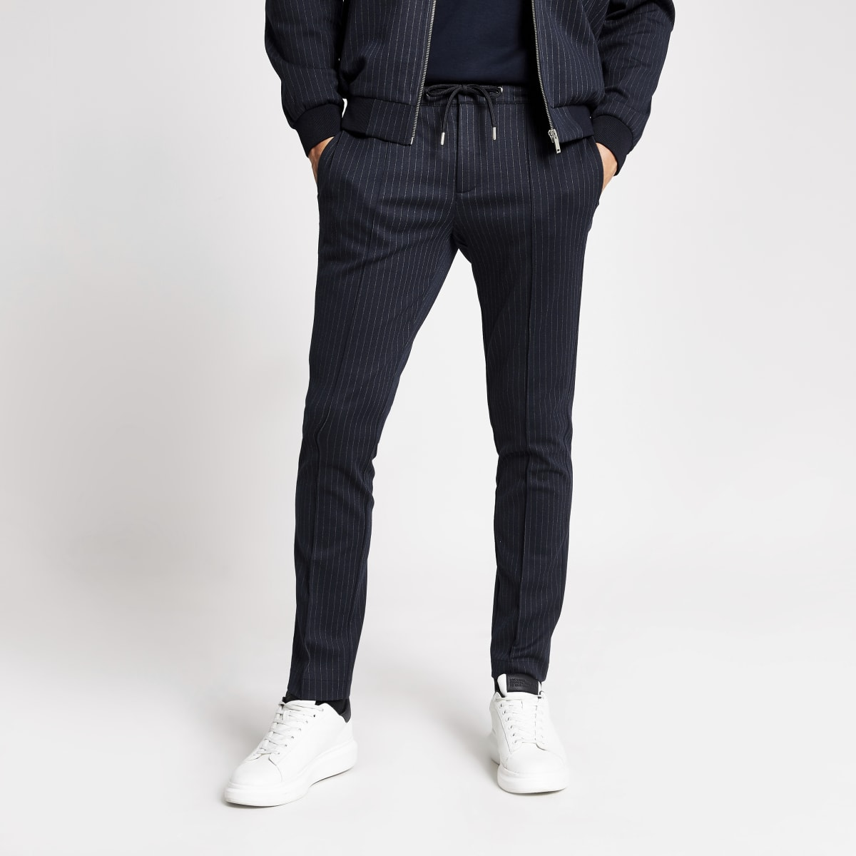 Elegante, marineblaue Skinny Fit Jogginghosen mit Streifen