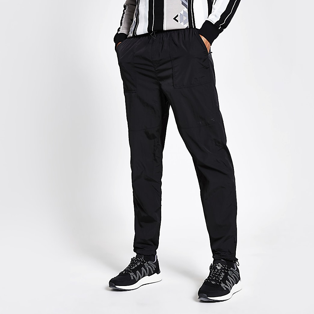 Pantalons de jogging noir en nylon avec bandes réfléchissantes