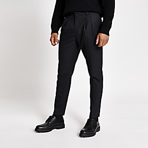 Schwarze eng zulaufende Hose in Skinny Fit mit doppelter Faltung