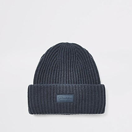 Prolific navy fisherman knitted hat