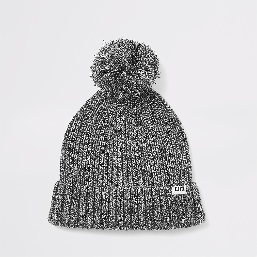 Grey twisted knit bobble hat