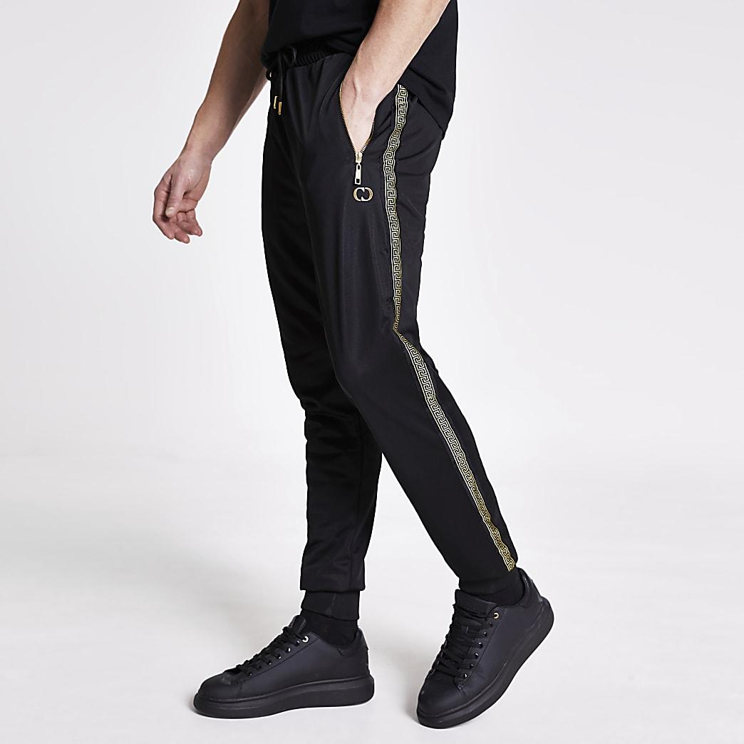 CriminalDamage Pantalons de jogging noirs avec bande imprimé baroque