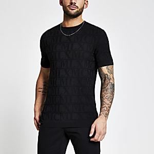 Zwart gebreid  T-shirt metMCMLX in reliëf