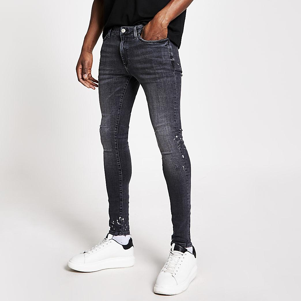 Ollie - Zwarte spray-on skinny jeans met verfspetters