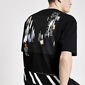 Zwartboxy-fit T-shirt met print achterop
