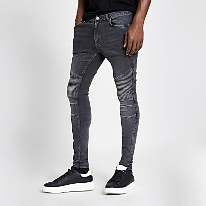 Grey biker spray on skinny jeans