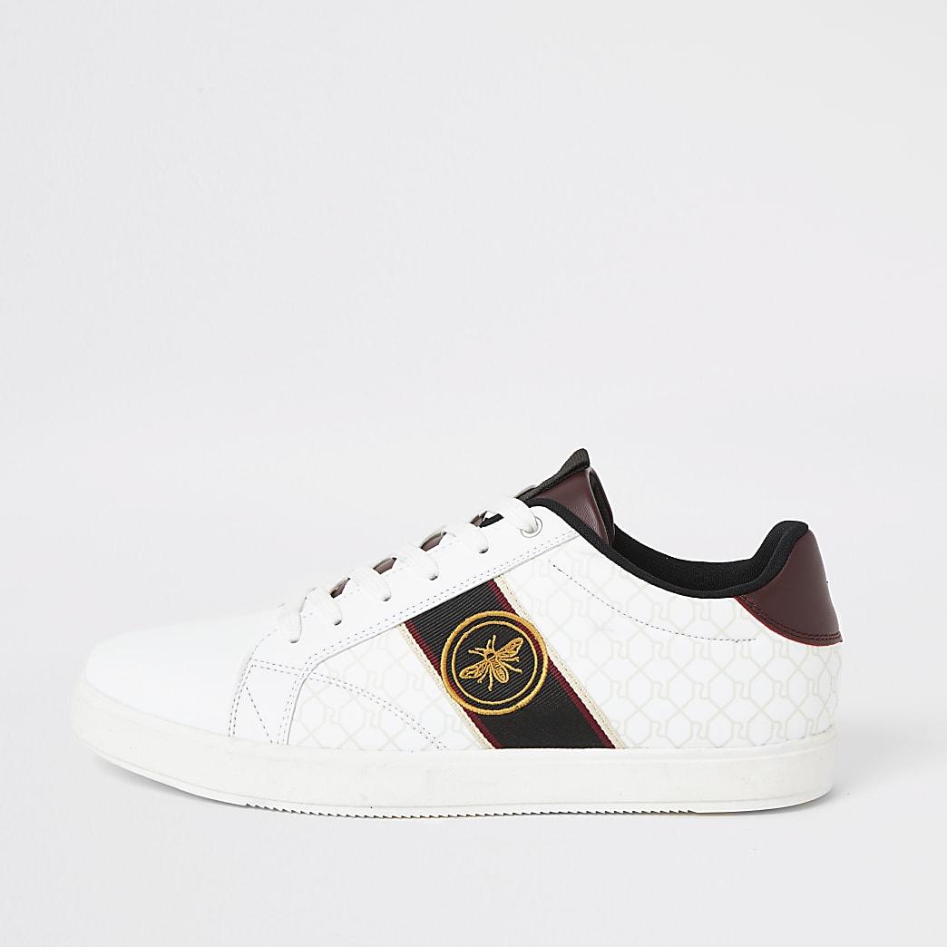 Witte RI sneakers met wesp borduursel en vetersluiting
