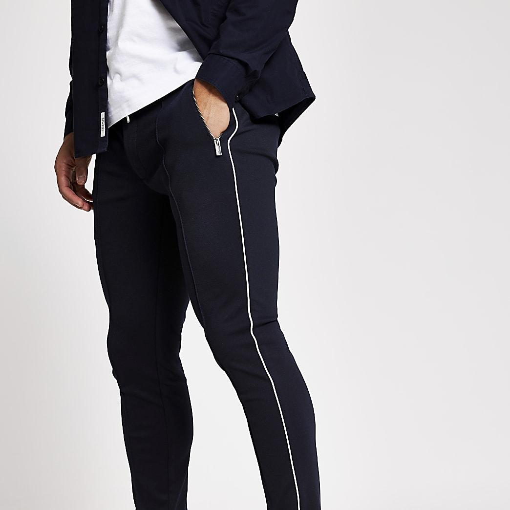 Marineblauwe superskinny nette joggingbroek met streep langs zijkant