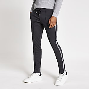 Elegante Super Skinny Fit Jogginghose in Grau mit seitlichem Tape