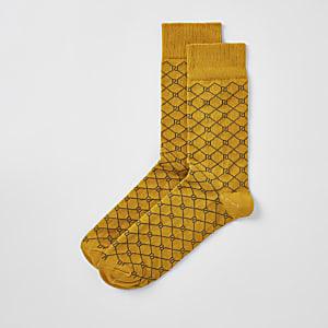Gelbe Socken mit RI-Monogramm-Muster