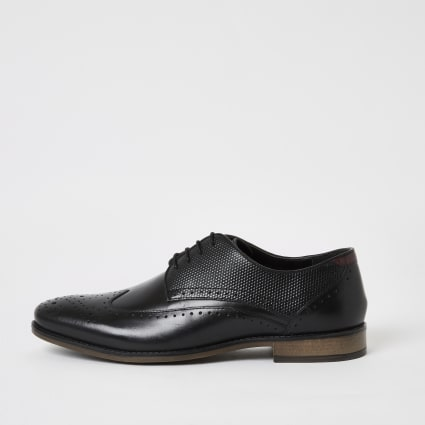 Black leather embossed lace-up brogues