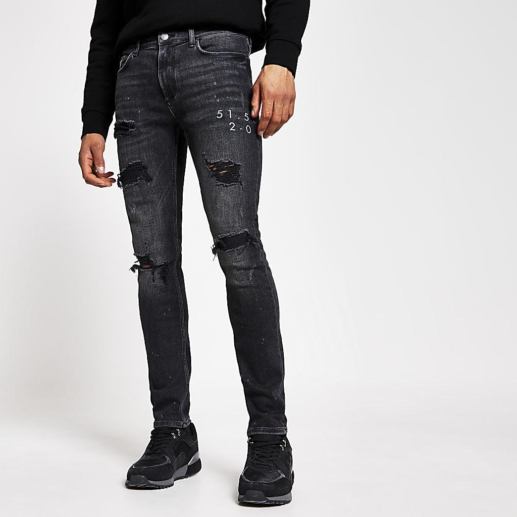 Schwarze Sid Super Skinny Jeans im Used-Look