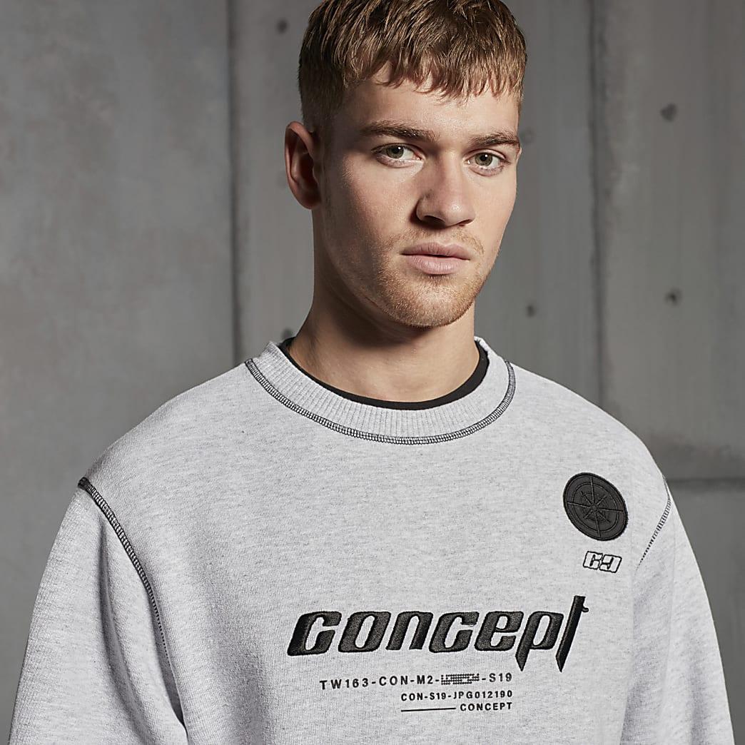 Concept – Sweat gris avec surpiqûres contrastées