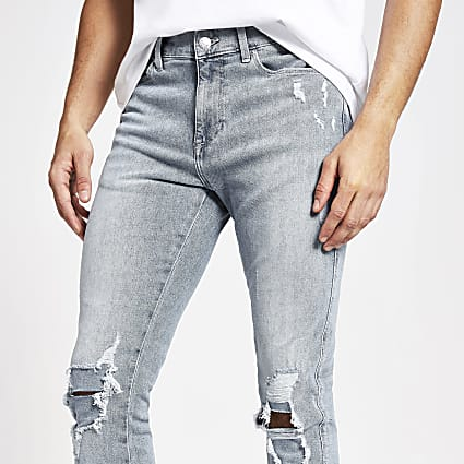 Light blue ripped Sid skinny jeans