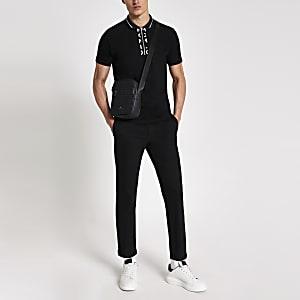 MCMLX  – Schwarzes Slim Fit Poloshirt mit kurzem Reißverschluss