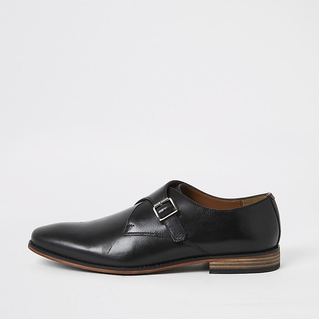 Zwarte leren schoenen met gespen