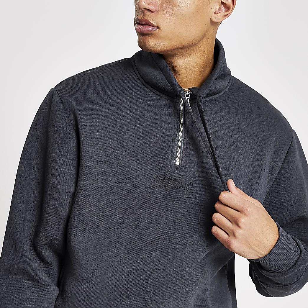 Blauwe sweater met prints, halve ritssluiting en trechterhals