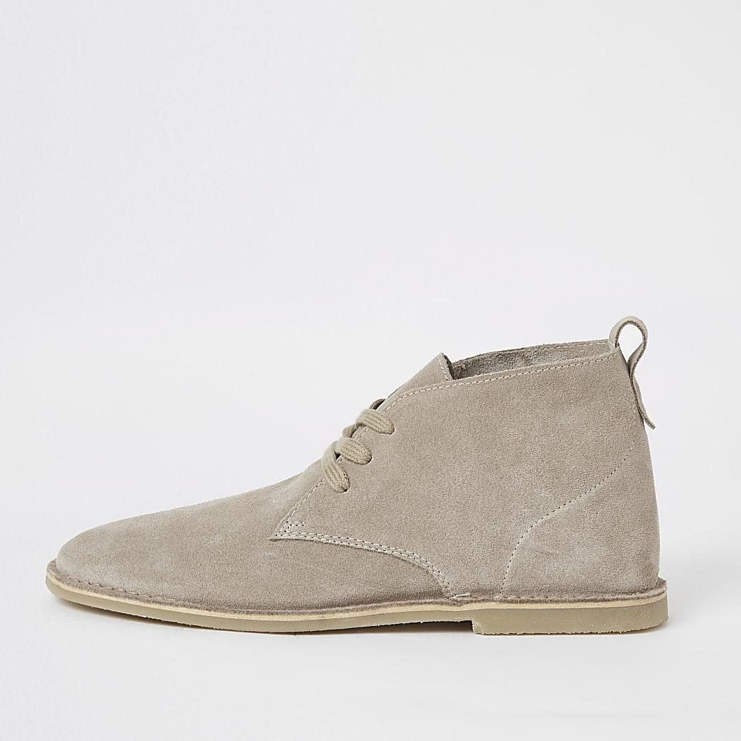 Ecru suede lace-up desert boots
