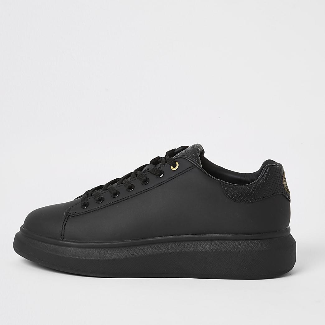 Baskets noires à semelle concave épaisse