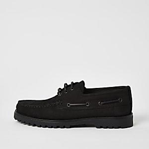 Chaussures bateau en cuir noir à semelle épaisse