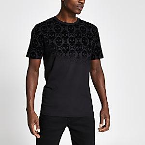 Zwart fluwelen slim-fit T-shirt met vervagende doodshoofden