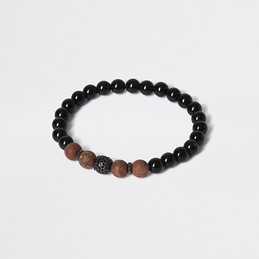 Bracelet en perles de pierres noires et marron