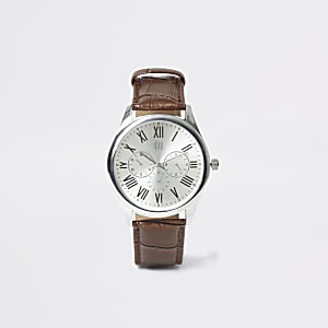 Elegante Armbanduhr in Silbertönen mit braunem Streifen