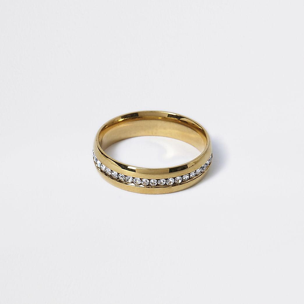 Goudkleurige ring verfraaid met siersteentjes