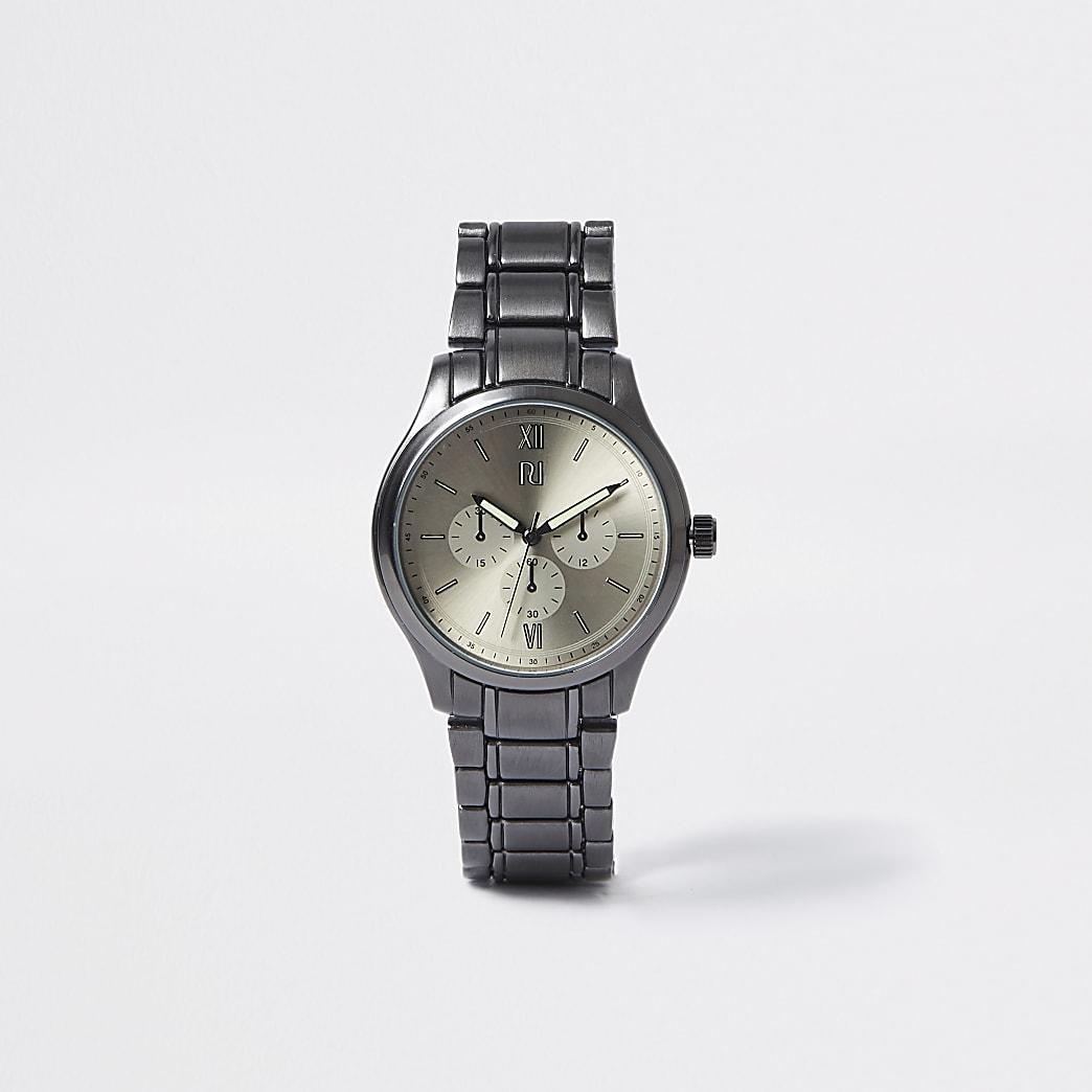 Metaalgrijs rond horloge met schakelbandje