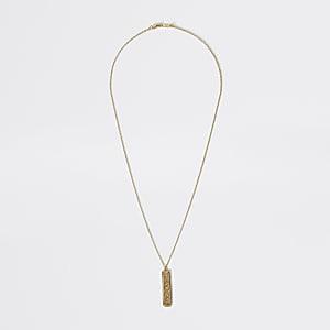 Collier doré avec pendentif bâton texturé