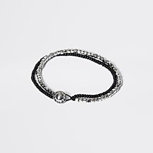 Gelaagde armband met zwarte en zilverkleurige kralen