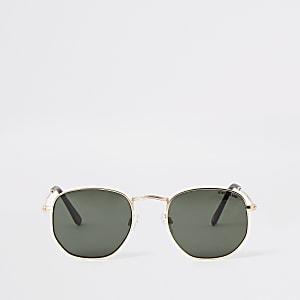 Goldene Sonnebrille in sechseckiger Form